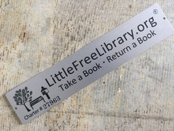 Photograph of our Little Free Library Charter number, from wwwlittlefreelibrary.org
